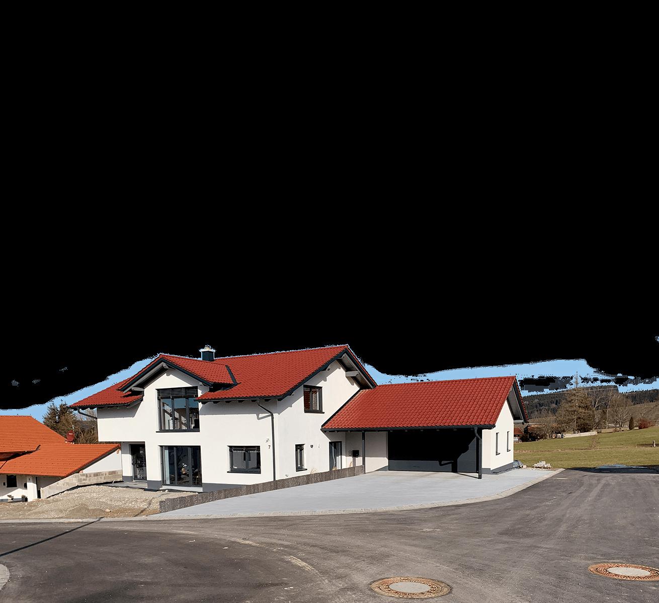 fertiger Neubau mit einem roten Dach von HoferDach